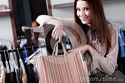 Smiling woman with paper bags