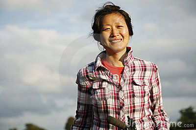 Smiling woman in the park - 02