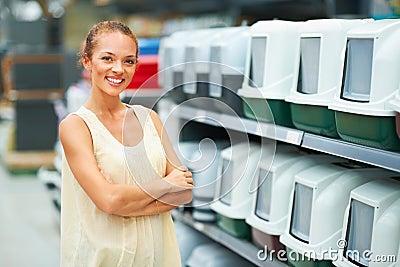 Smiling woman at pet shop