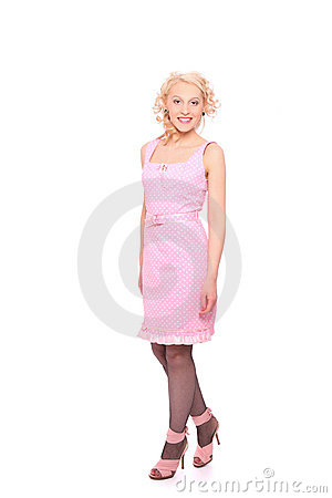 Smiling woman in a pink spotted dress