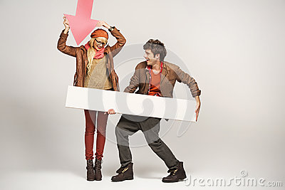 Smiling woman pointing on empty board