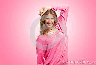 Smiling woman portrait against pink background