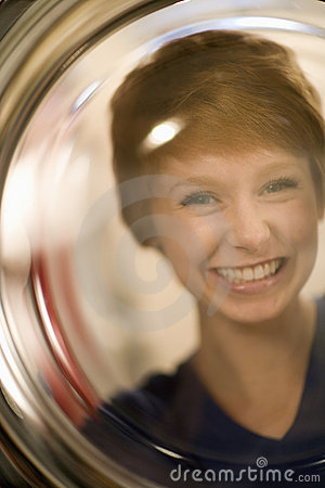 Smiling woman portrait through glass