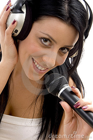 Smiling woman posing with headphone and microphone
