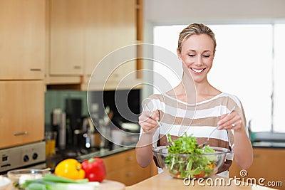 Smiling woman preparing meal
