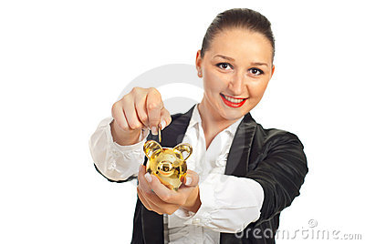 Smiling woman put coin in piggybank