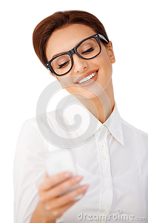 Smiling woman reading a text message