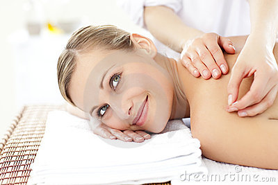 Smiling woman receiving an acupuncture treatment