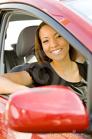 Smiling woman in red car