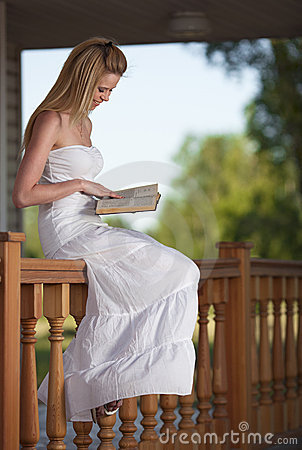 Smiling woman relax with book