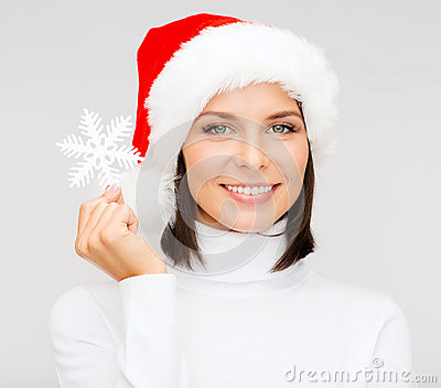 Smiling woman in santa hat with big snowflake