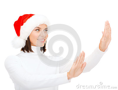 Smiling woman in santa helper hat