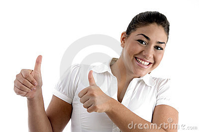 Smiling woman showing good luck gesture