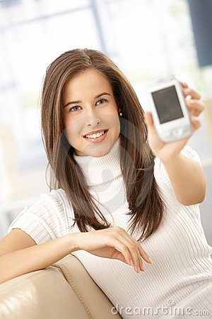 Smiling woman showing mobile phone
