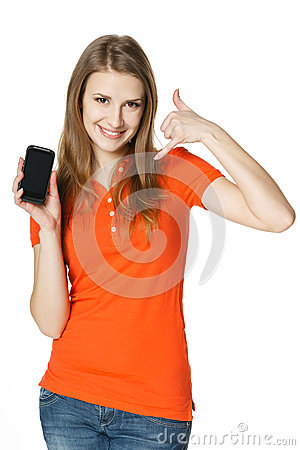 Smiling woman showing mobile phone making call me gesture