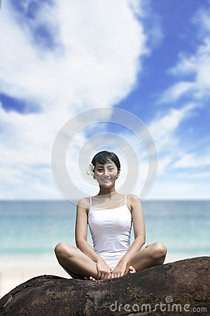 Smiling woman sitting at beach