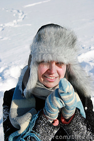Smiling woman on the snow