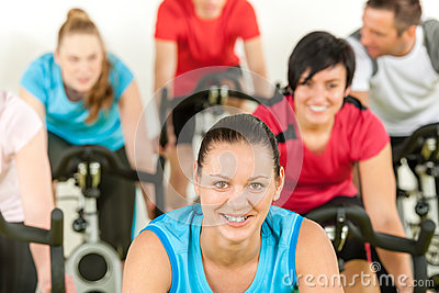 Smiling woman at spinning class fitness workout