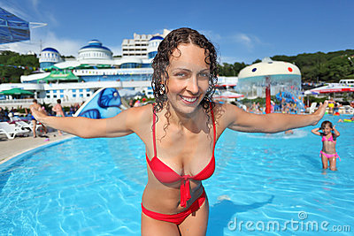 Smiling woman standing in pool