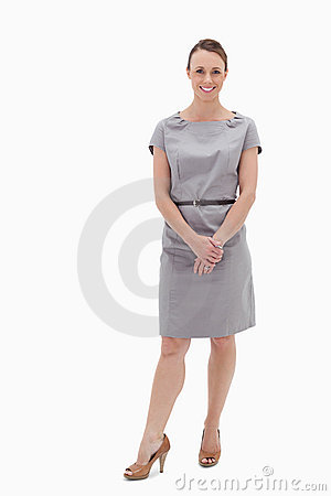 Smiling woman standing up and holding her hands
