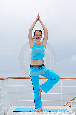 Smiling woman stands and does exercise