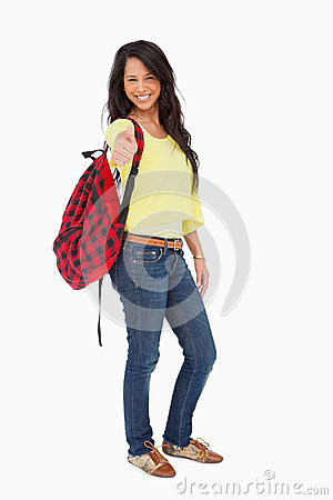 Smiling woman student thumb-up with a backpack