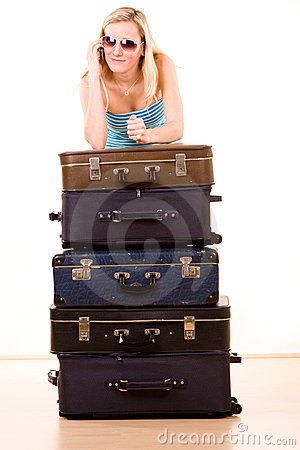 Smiling woman with suitcases