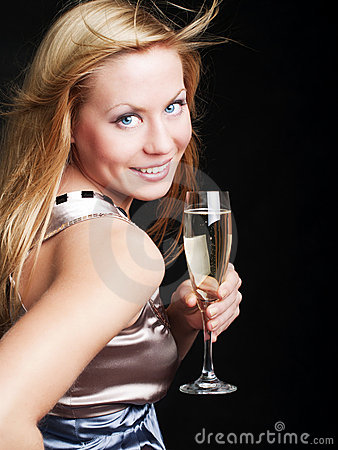 Smiling woman with sylvester champagne over dark