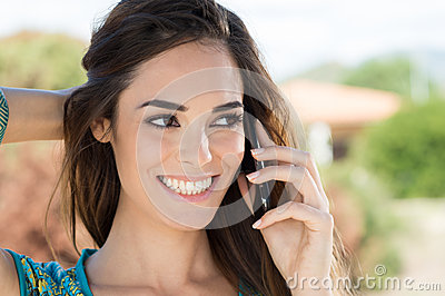 Smiling Woman Talking On Cellphone