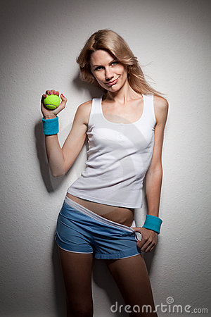 Smiling woman with a tennis ball