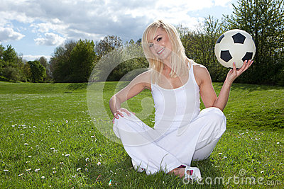 Smiling woman about to throw a football