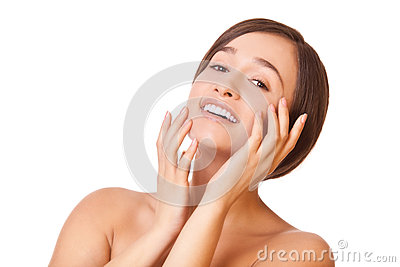 Smiling woman touching face