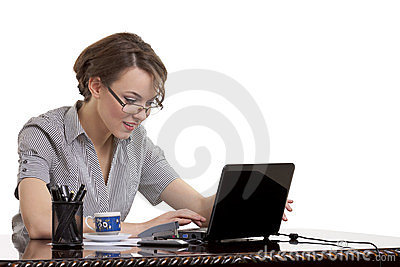 Smiling woman typing on keyboard