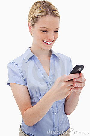 Smiling woman writing text message