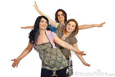 Smiling women with arms up