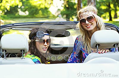 Smiling women in a cabrio
