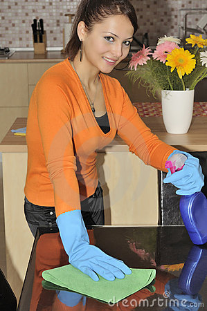 smiling women cleaning the house