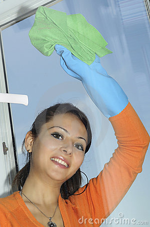 smiling women cleaning a window