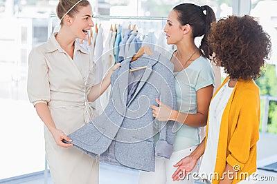 Smiling women holding a blazer