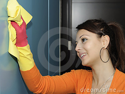smiling women worker cleaning the house - wardrobe