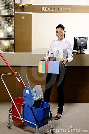 Smiling worker cleaning the hotel