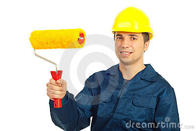 Smiling worker man holding paint roller