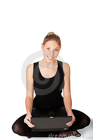Smiling yong woman sitting on floor
