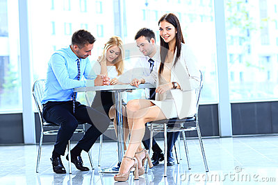 Smiling young attractive business woman in a meeting