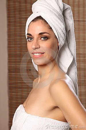 Smiling young beautiful woman wearing bath towel