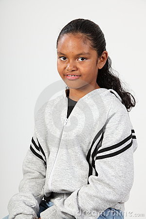 Smiling young black girl 10 wearing grey sweater