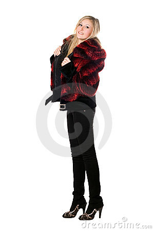Smiling young blond woman in a fur jacket