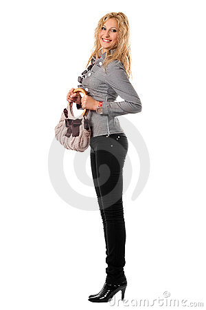 Smiling young blonde with a handbag. Isolated