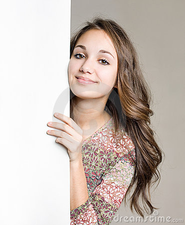 Free Smiling Young Brunette Girl With Blank White Sign. Royalty Free Stock Image - 22672006