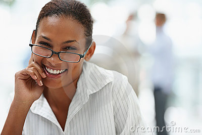 Smiling young business woman wearing spectacles